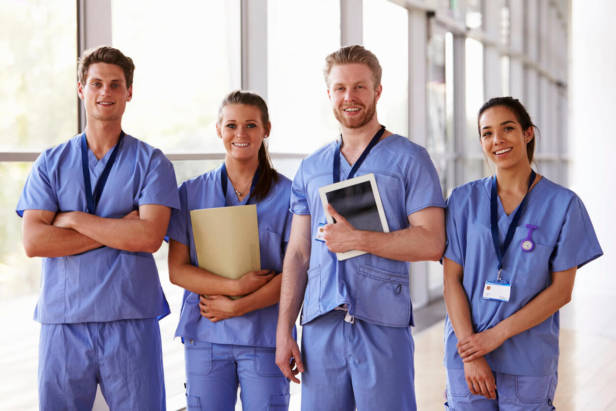 group of 4 medical professionals in scrubs